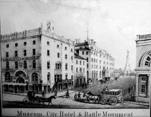 Museum City Hotel and Monument square looking north from Baltimroe Street whiter